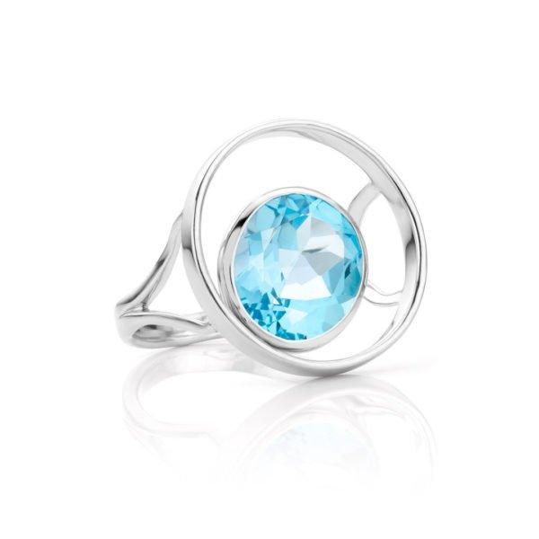Audrey Huet Joaillerie : Bague ONE or blanc 18 carats topaze blue swiss symbole d'audace et d'élégance MADE in Belgium pour des femmes de caractère